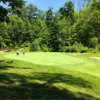 A sunny day view of a green at Aston Oaks Golf Club
